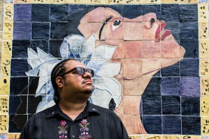 Troy Burton, executive director of the Eubie Blake Center, in front of its famed Billie Holiday mural.