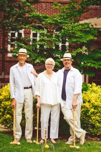 Painter Harriet Cole joins Russ Volker (left) and his husband, Mark Panos Volker, at a croquet-themed Friday happy hour in the courtyard.