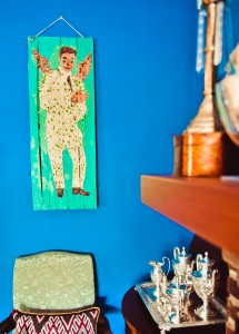 Artwork by the Baltimore Glass Man hangs against James Magruder and Steven Bolton's blue wall.