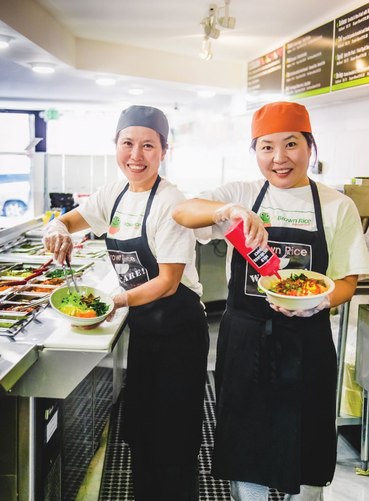 Sisters Unmi Kim, left, and Heather Chung believe food should be prepared with a smile.