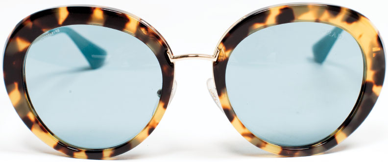 PRADA, PRADA, PRADA Round tortoiseshell glasses are back big time, but we prefer this shaded Prada pair that creates a more cosmopolitan persona. For your choosiest giftee. $375, at Handbags in the City in Harbor East.
