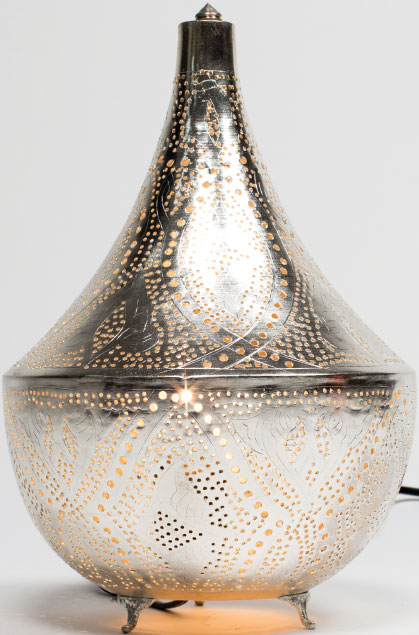 HOLIDAY LIGHTS These unique metal lanterns from Turkey are made of stainless steel or copper. They add versatile flair—and warmth—to any home or office. $220, at Karavan in Annapolis.
