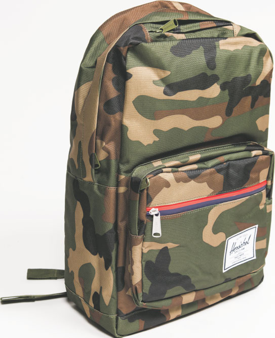 "BEHIND YOU! Just like our kids, we're goners for the backpack trend. This fun number by the Herschel Supply Co., the ""Pop Quiz"" camo backpack, is on our own wish list. $70, at South Moon Under in Harbor East."