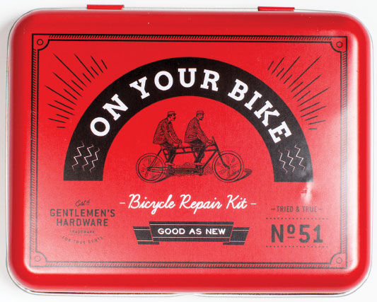 "BICYCLE CHIEF Who on your list is at top risk for…flat tires? On Your Bike vintage-style repair kit comes with non-rubber patches in three sizes, two metal ""tyre"" levers, a bone wrench, a metal rast, 20 mm. of rubber solution and instructions! $23, at TROVH in Hampden."