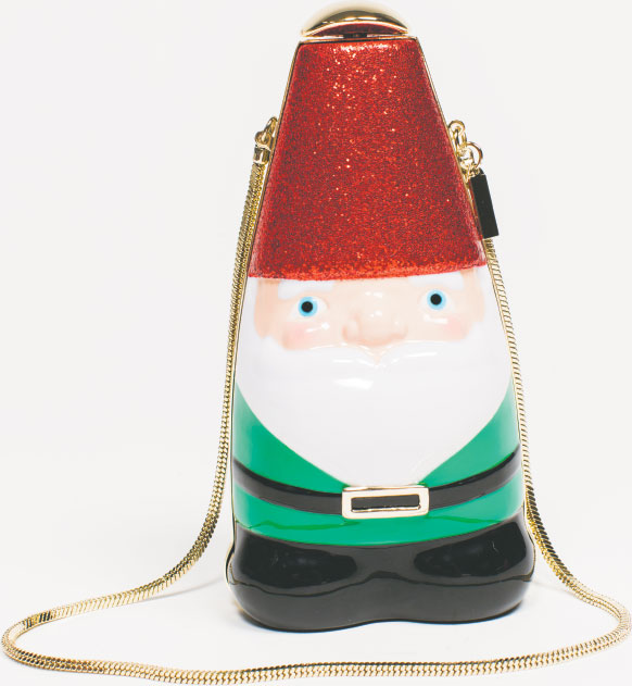 JUST SAY GNOME The Kate Spade Blaze a Trail Gnome Clutch reminds us of specialty party purses our grandly attired grandmother used to own. $398, at Handbags in the City in Harbor East.