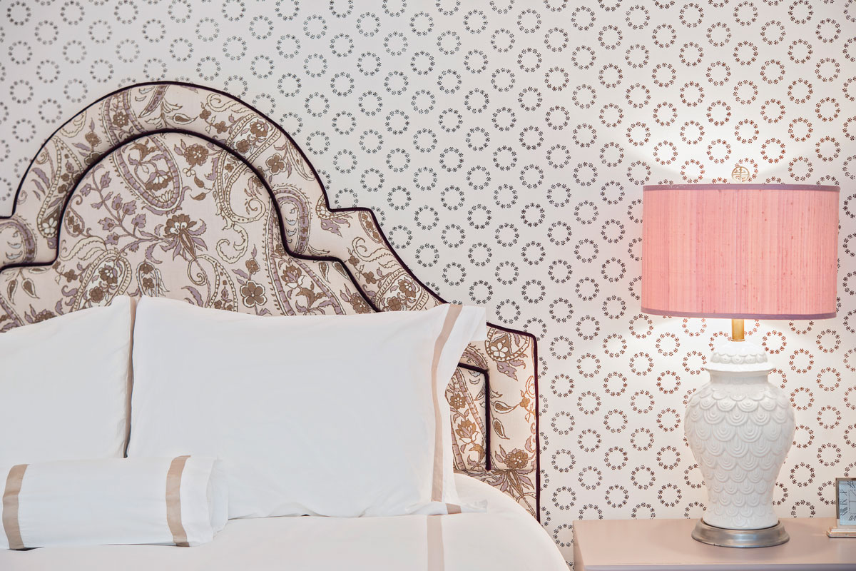 Custom headboard is covered in fabric by Cowtan and Toutlampshade is by Hillary Thomas.