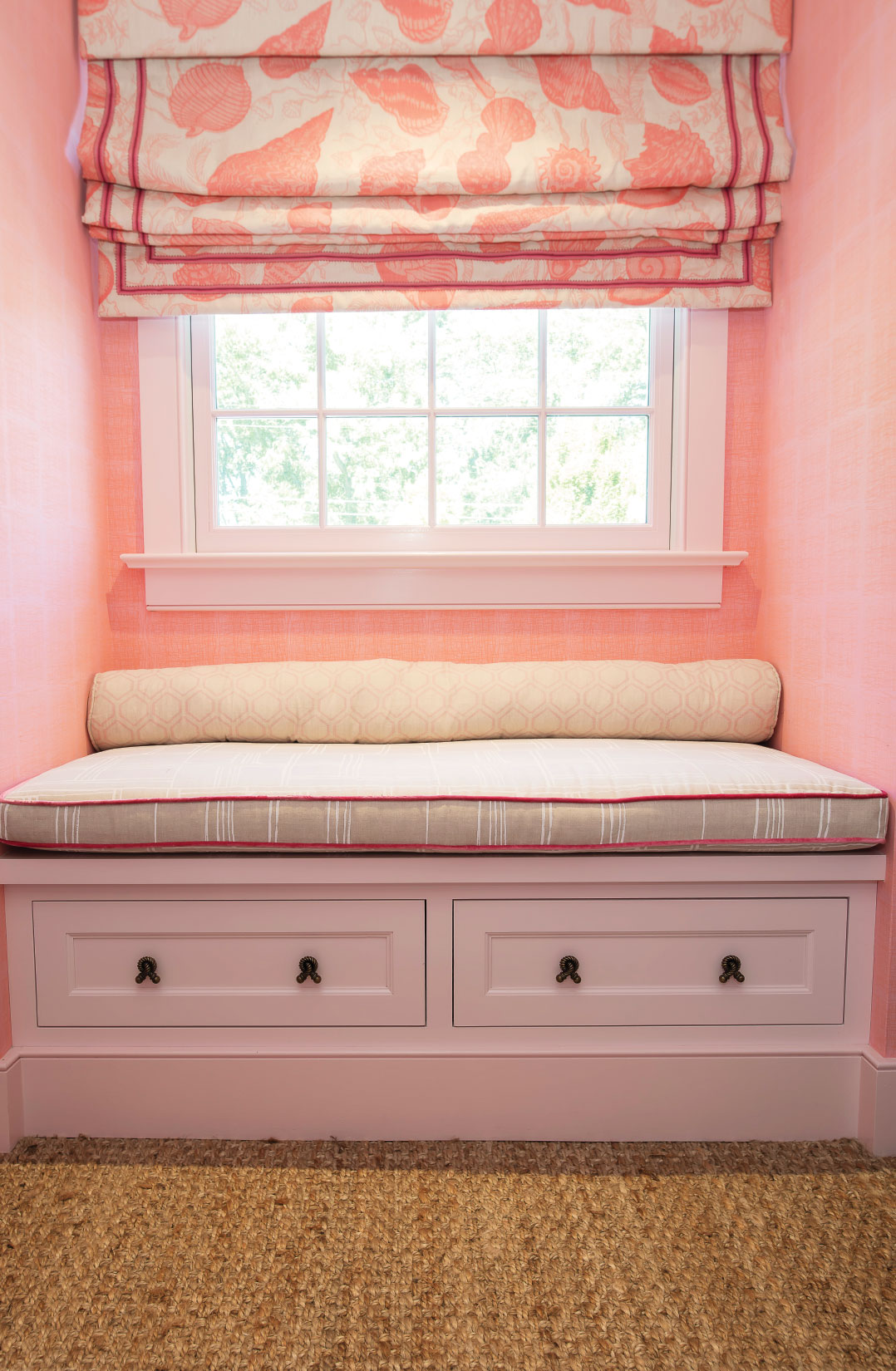 A sweet window seat in the little girl's room features Christopher Farr fabric with Quadrille velvet welting