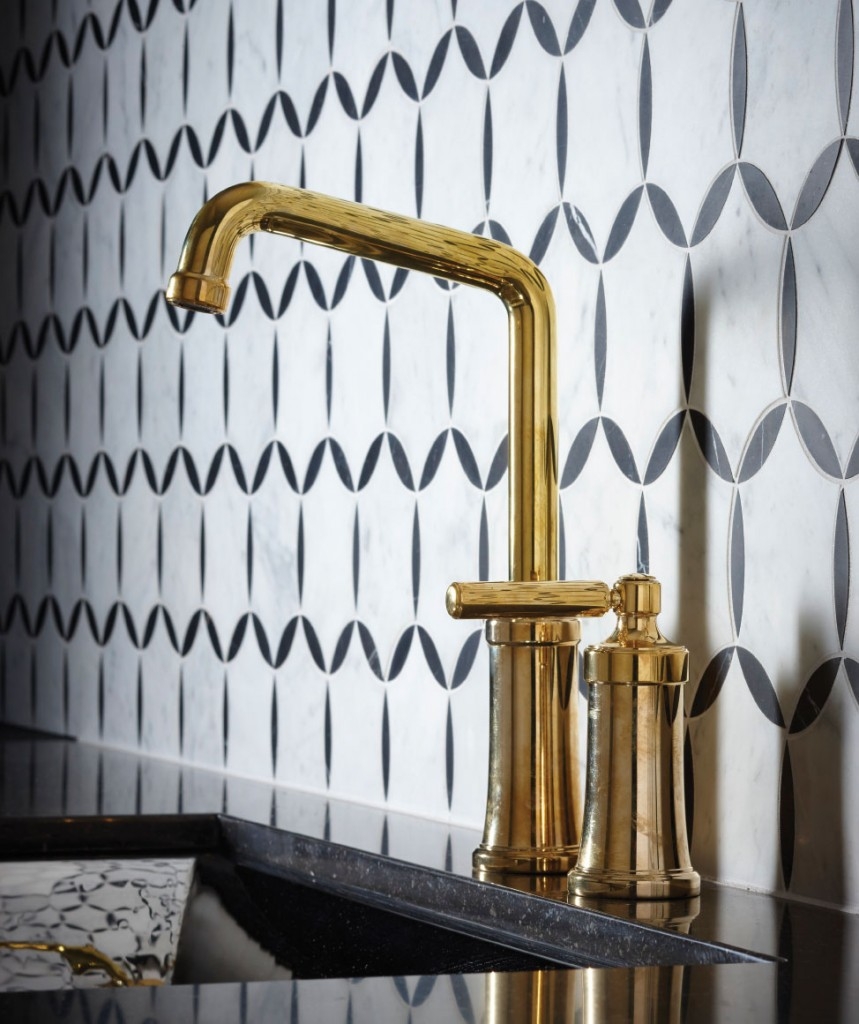 This sleek Kallista Quincy Entertainment Faucet balances with the playfully patterned wall for a sophisticated look.