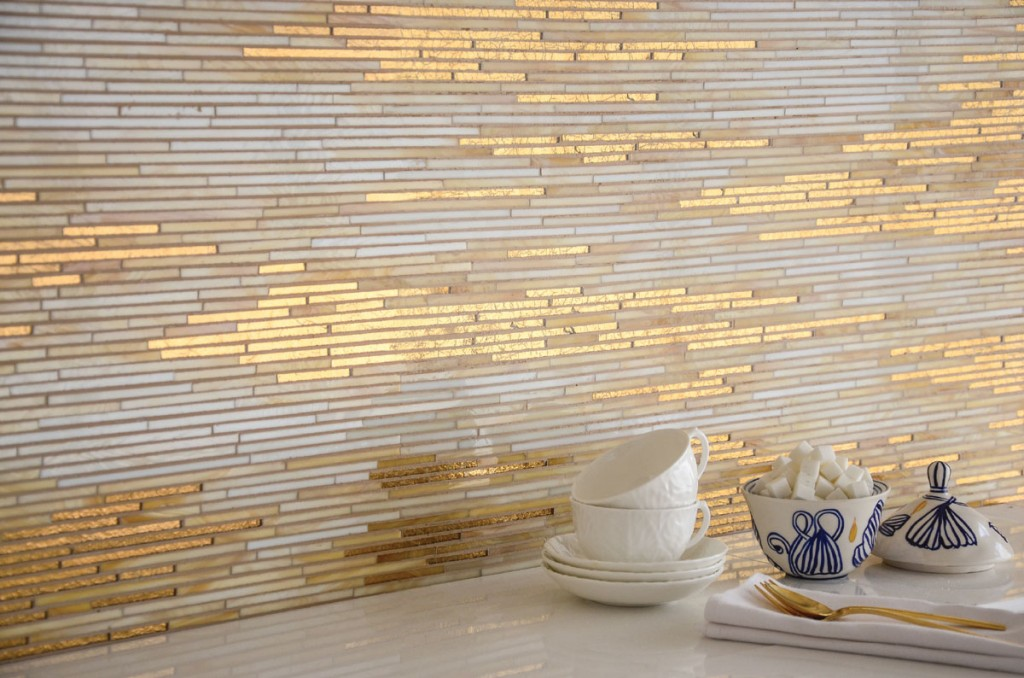 Ruche, a stone water jet mosaic, shown in polished Calacatta, polished Thassos and Cream Onyx, is also designed by Sara Baldwin for New Ravenna.