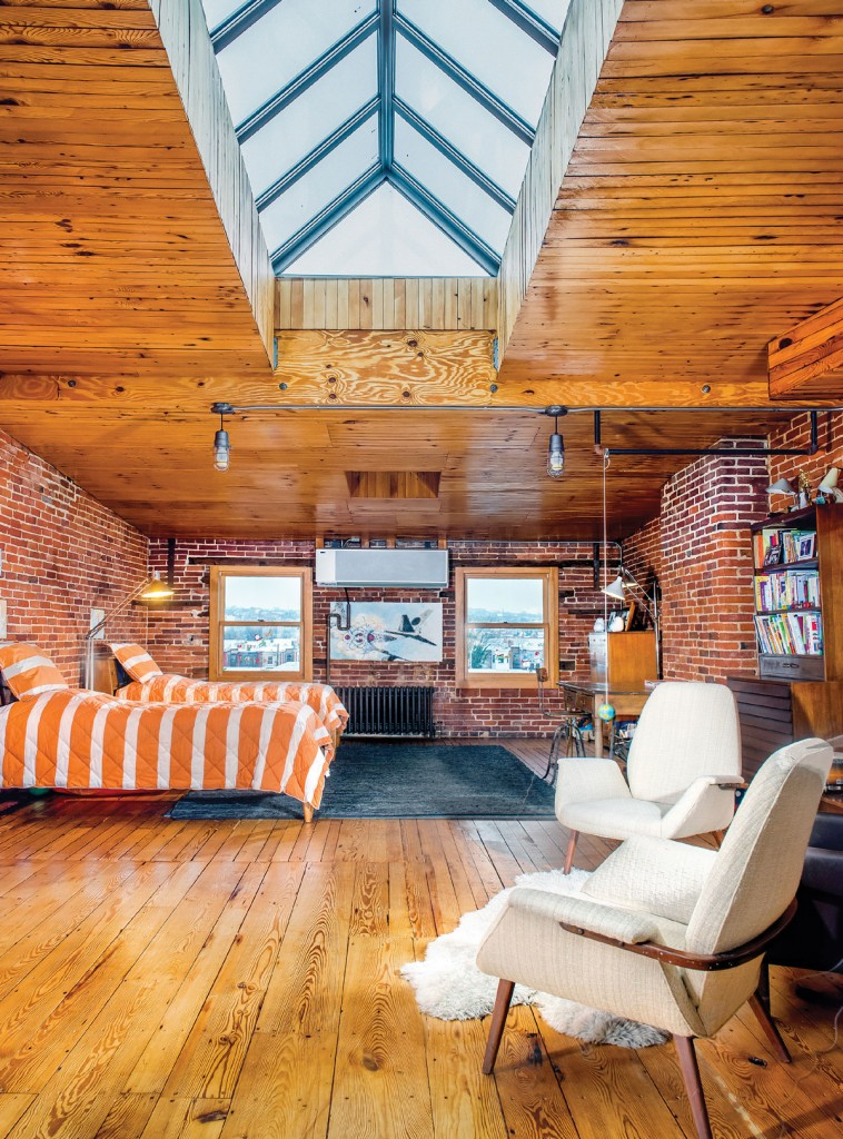 Originally, the fourth floor was slated to be Naylor's studio or the master bedroom. Instead, it has been adopted by the couple's boys. A 45-foot skylight runs down the center of the room, flooding the floor with light, easily making it the best spot in the house.