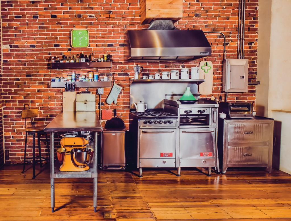 The second-floor kitchen features a family table and wall bins from DePaulo and Sons in Baltimore. The stove is an old Franklin Chef, and the cabinet is an old file cabinet from a shop in Brooklyn—it's been stripped and refinished.