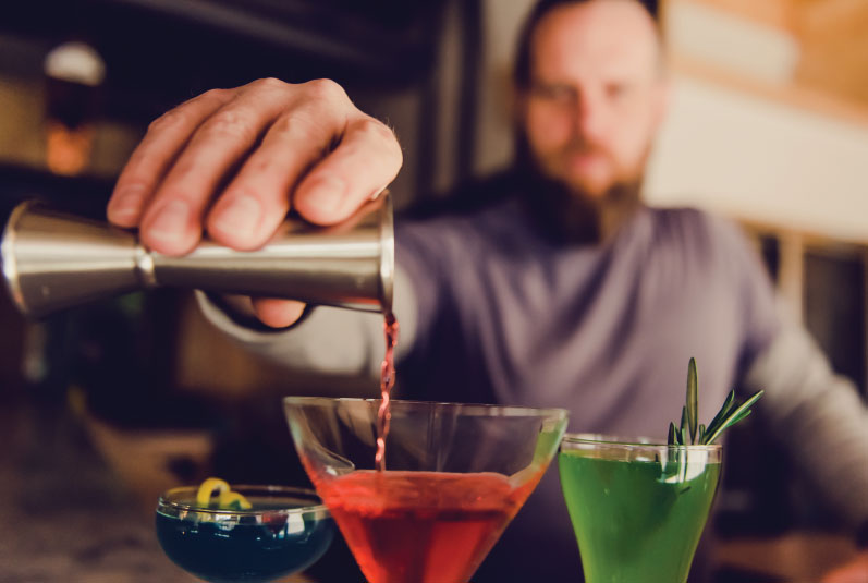 bar manager Ian Clark pours classic cocktails