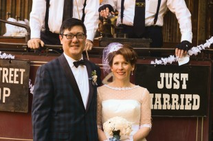 """They said """"I do!"""" Howard Yang and Kathy Flann, and their friendly trolley conductors for the evening."""