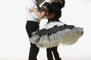 Square dancers in black and white costumes --- Image by © Erik Isakson/Corbis