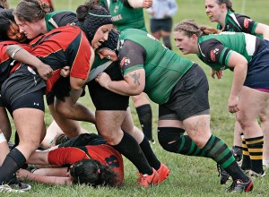 Lauren Harris (front, right) of the Chesapeake Ospreys clashes with an opponent from the Maryland Stingers during a rugby football game April 23 at Frank C. Bocek Park in Baltimore.