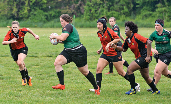 Erin Sylvester of the Chesapeake Women's Rugby Football Club runs with the ball as members of the Maryland Stingers give chase during a game April 23 at Frank C. Bocek Park in Baltimore.