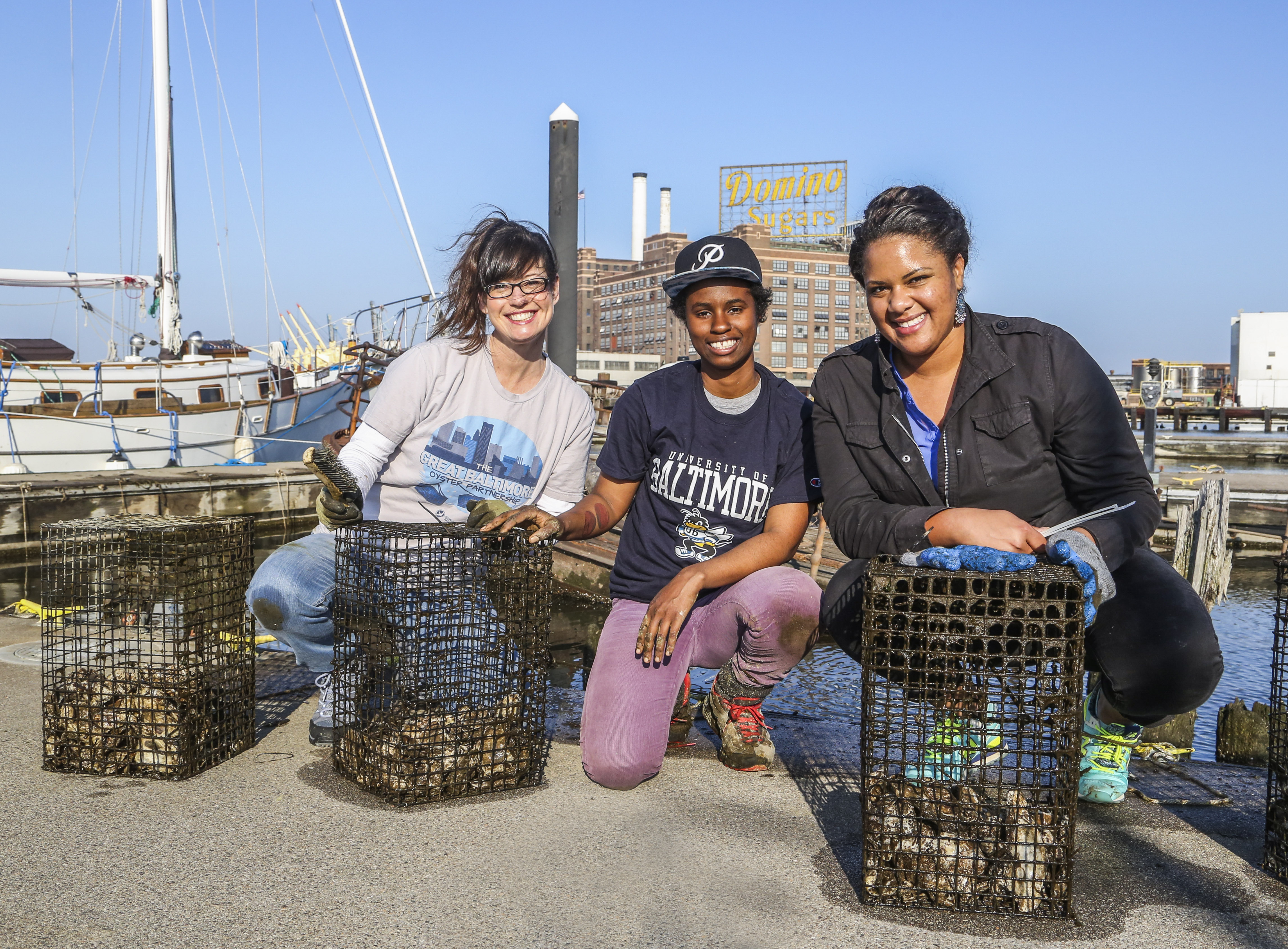 Tammy Dexter, Lanae Jackson and Carmera Thomas clean oyster cages.