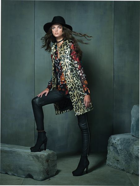 "Urban Jungle Sheer floral print blouse, $495; faux fur vest, $390; both by Alice + Olivia at Neiman Marcus, Tysons Galleria. Black leather leggings with side zipper by Vince, $1,095 at L'Apparenza, Falls Road. Black maxi fedora by Eugenia Kim, $375 at Neiman Marcus, Tysons Galleria. Black suede platform booties by Robert Clergerie, $675 at Ruth Shaw, Cross Keys. Black leather choker with gold chain by FordamRowe, $45 at Katwalk Boutique, Fells Point. Gold orb ""Copernicus"" ring, by H. Stern Jewelers, $7,500 at Radcliffe Jewelers, Pikesville."