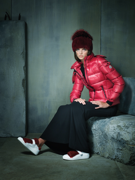 "Sporty spice. Red ""Bady Giubbotto"" puffer coat, $1,045 and ""Lucie"" sneaker with fur adornment, $495, both by Moncler, at Moncler, CityCenterDC. Red fur beanie with fox pom-pom, $295 at Mano Swartz, Green Spring Station. Black matte jersey long-sleeved gown with leather detailing by Alice + Olivia, $330 at L'Apparenza, Falls Road."