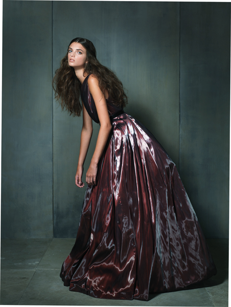 Shine Wine. Marsala draped one-shoulder ball gown made of liquid satin with asymmetrical metal belt by Romona Keveza Collection, $7,990 at Francesca's Atelier, Green Spring Station. Amethyst teardrop earrings by Assil New York, $6,240 at Radcliffe Jewelers, Pikesville.