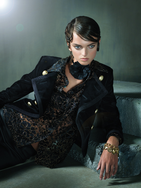 Black Russian. Black cropped velvet jacket with gold buttons, $3,490 and black and gold lace blouse, $1,690; both by Saint Laurent Paris at Saks Fifth Avenue, Chevy Chase. Flower choker with metallic pinstripe and velvet ribbon by Jill Andrews Gowns, $75 at Jill Andrews Gowns, Hampden. Black stretch leather pants by Helmut Lang, $920 at Saks Fifth Avenue, Chevy Chase. Charm bracelet by Yoshi, $64 at The Little Shoebox, Ruxton.