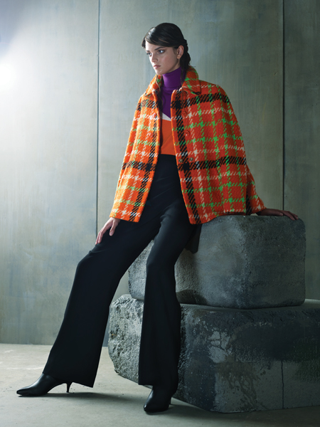 "Mad for Plaid. Orange oversized tartan plaid coat, $1,450 and multicolored bright turtleneck, $535; both by Boutique Moschino at Ruth Shaw, Cross Keys. Black wide-legged ""Casablanca"" trouser by Cinq á Sept, $395 at Saks Fifth Avenue, Chevy Chase. Black suede and leather bootie by Butter, $391 at the Little Shoebox, Ruxton."
