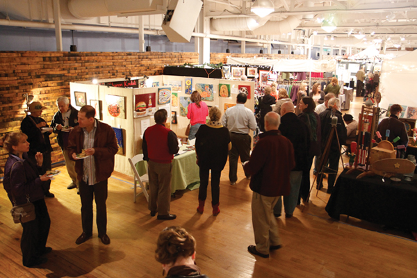 holiday shoppers mingle amid Bazaart booths in the Jim Rouse Visionary Center