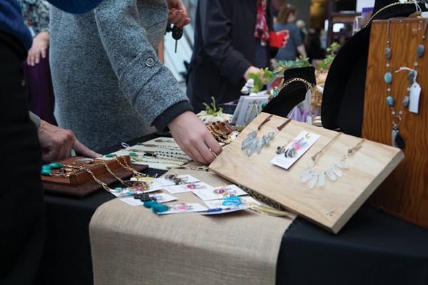MICA Art Market shoppers check out handcrafted jewelry made with crystals and stones.