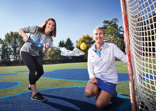 Garrison Forest alum Liza Blue works out with Traci Davis, the GFS athletic director.