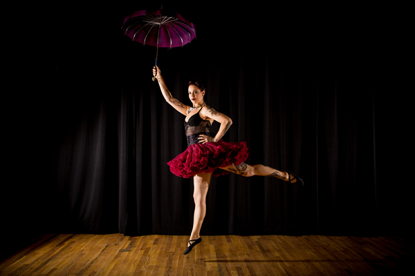 "Parasol Dancer: Abby Stone from The Ideal Arts Space ""is an instructor, performer and creative director. Her passion for all things movement related is reflected in her pose as a turn-of-the-century parasol dancer,"" notes calendar text."